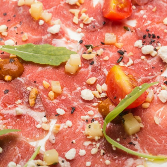 Iberain veal carpaccio with diced, thyme-seasoned Idiazabal cheese and truffle olive oil